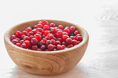 Cranberries in wooden dish Royalty Free Stock Photography