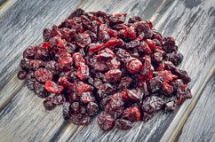 A healthy dried snack. Cranberries on a wooden table royalty free stock photos