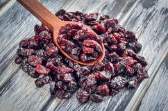 A healthy dried snack. Cranberries on a wooden table stock image