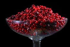 Cranberry. Berries red red bilberry, in glass vases on a black background Stock Photography