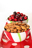 Cranberry & almonds in a bowl with polka dots. Shot of cranberry & almonds in a bowl with polka dots on white Stock Images