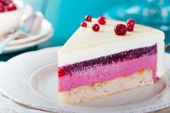 Cranberry, bilberry, raspberry tart, mousse cake. Cranberry, bilberry, raspberry tart, mousse cake, pie, cheesecake with fresh bilberries on a blue wooden Stock Image