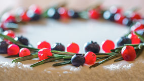 Cranberry and blueberry on Christmas cake Stock Photo