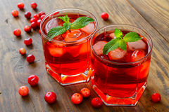 Cranberry cocktail with ice stock images