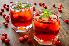 Cranberry cocktail with ice and mint royalty free stock photography