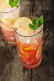 Cranberry cocktail with ice, mint, lemon and apple Stock Images
