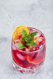 Cranberry cocktail with ice and mint. Cranberry mandarin orange cocktail with ice and mint Royalty Free Stock Image