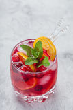 Cranberry cocktail with ice and mint. Cranberry mandarin orange cocktail with ice and mint Stock Photo