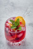 Cranberry cocktail with ice and mint. Cranberry mandarin orange cocktail with ice and mint Royalty Free Stock Photography