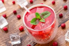 Cranberry cocktail with mint garnish. Royalty Free Stock Images