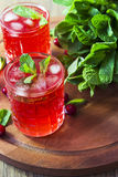 Cranberry cocktail with mint and ice. Cranberry cocktail with ice mint Royalty Free Stock Images