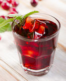 Cranberry cocktail with mint on  white wooden table. Stock Photo
