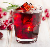 Cranberry cocktail with mint. On a wooden background. Selective focus Royalty Free Stock Photography