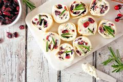 Cranberry, cream cheese pinwheel appetizers, top view white table scene stock image