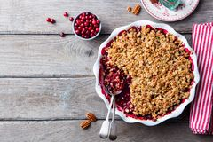 Cranberry crumble, crisp in a baking dish. Wooden background. Top view. Copy space. Cranberry crumble, crisp in a baking dish. Wooden background. Top view. Copy royalty free stock image
