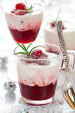 Cranberry dessert with cream. And sugared cranberries for Christmas stock photos