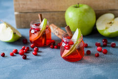 Cranberry drink with apples in glass cups. Royalty Free Stock Photo