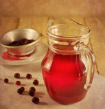 Cranberry drink in a glass pitcher Royalty Free Stock Images