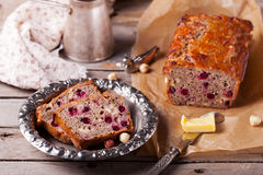 Cranberry and hazelnut wholegrain bead, loaf. On a wooden background. Rustic style. Wooden background Royalty Free Stock Photography