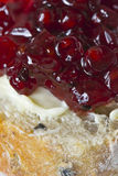 Cranberry jam on buttered bread Stock Photo