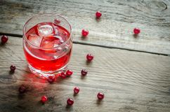 Cranberry juice. With fresh cranberries on the wooden background Royalty Free Stock Photos