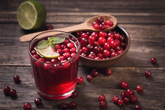 Cranberry juice on old wooden table Stock Photo