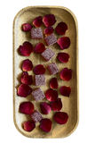 Cranberry marmalade and rose petals on a wooden tray Royalty Free Stock Photo