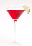 Cranberry Martini. Red cocktail with a lime wedge Stock Images