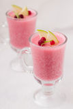 Cranberry mousse. In a glass on the table Stock Photography