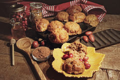 Cranberry muffins with berries on table Royalty Free Stock Photos