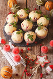 Cranberry muffins with Christmas decorations close-up. Vertical stock photos