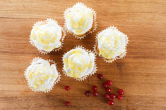 Cranberry muffins on wooden background. Stock Image