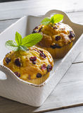 Cranberry muffins. On wooden background with mint Stock Photo