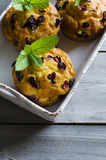 Cranberry muffins. On wooden background with mint. Copy space Stock Photo