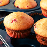 Cranberry muffins on wooden background. Royalty Free Stock Images