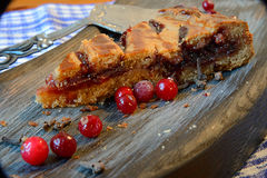 Cranberry pie. On a textured cutting Board Royalty Free Stock Image