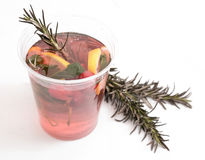 Cranberry refreshing tea hot or cold in the winter or summer, with lemon and rosemary with the addition of mint. Royalty Free Stock Photo