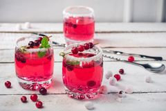 Cranberry sangria. Cranberry drink in a glass and berries, sangria royalty free stock photos