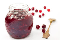 Cranberry sauce. Jar of cranberry jam and some fresh berries on white Royalty Free Stock Photography