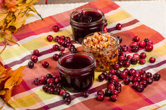 Cranberry sauce with cranberries and fall leaves Royalty Free Stock Photo
