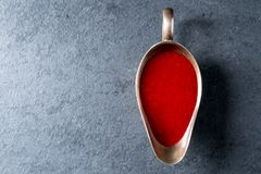Cranberry sauce in a gravy boat on gray slate free space Royalty Free Stock Photography
