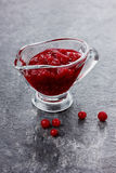 Cranberry sauce for meat. In a glass sauce boat Royalty Free Stock Photography