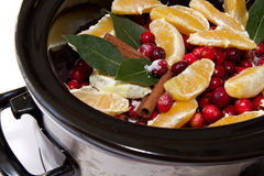 Cranberry sauce with oranges, cinnamon and bay leaf simmering in Royalty Free Stock Image