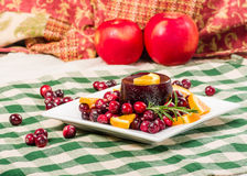 Cranberry sauce on plate with red apples Stock Photo