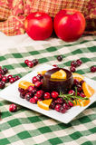 Cranberry sauce on plate with red apples Royalty Free Stock Image
