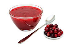 Cranberry Sauce with spoon. Cranberry Sauce, Glass bowl with cranberries, spoon, isolated on white background Royalty Free Stock Photography