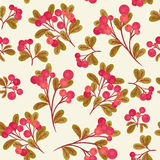 Cranberry seamless pattern. Seamless pattern with branches of red cranberries and green leaves on light cream background Royalty Free Stock Images