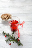 Cranberry tea on the boards Stock Photography