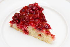 Cranberry upside-down cake. On white plate Stock Photography