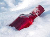 Cranberry vodka in the snow Stock Photography
